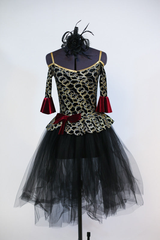 Gold/silver glitter pattern on black stretch velvet with off-the shoulder bodice and pep-plum rests on black tulle romantic tutu. Comes with black head piece. Front