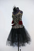 Gold/silver glitter pattern on black stretch velvet with off-the shoulder bodice and pep-plum rests on black tulle romantic tutu. Comes with black head piece. Side