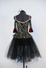 Gold/silver glitter pattern on black stretch velvet with off-the shoulder bodice and pep-plum rests on black tulle romantic tutu. Comes with black head piece. Back