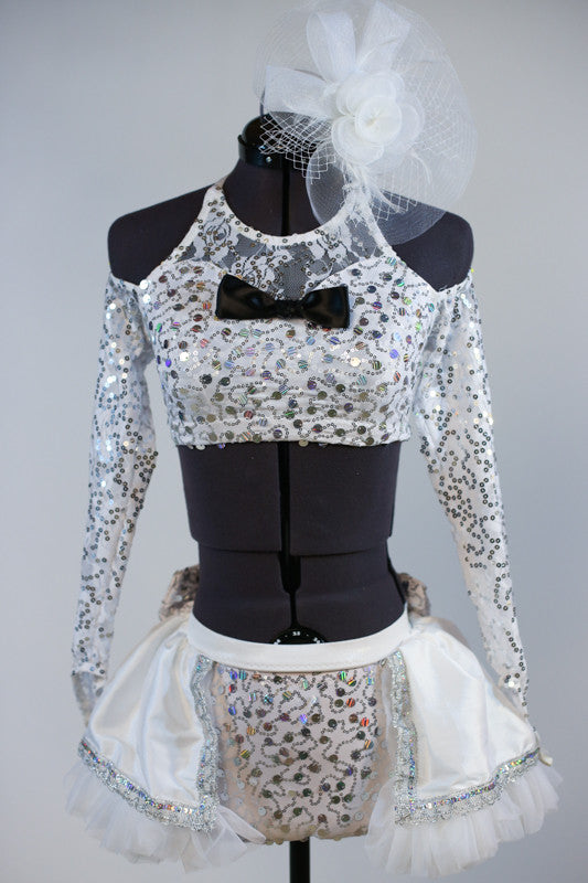 White and silver halter neck top with  long sleeves and a corset  lace-up back.Has black bow-tie accent .Comes with panty and white-silver, petticoat skirt. Front zoom