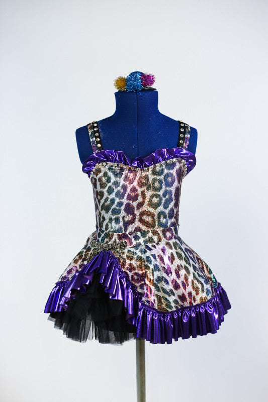 Shiny purple/gold/aqua, leopard print bodysuit with purple shiny ruffles and keyhole back. Matching skirt with black petticoat, & pom-pom hair piece. Front