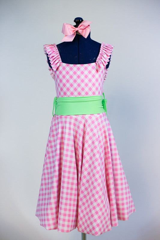 Pink and white gingham pattern dress with built in panty, shoulder ruffles and a pale green sash. Front