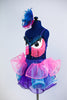 Blue sequined bra top that has monster eyes and pink fringe, Skirt is layers of twisty organza in bright pink, turquoise and purple. comes with hair piece, Side