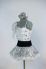White  lace/sequined bodysuit has jeweled shoulder ruffle Comes with a silver/white ruffled skirt - black velvet waistband and a  silver orchid hair piece. side