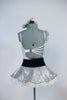 White  lace/sequined bodysuit has jeweled shoulder ruffle Comes with a silver/white ruffled skirt - black velvet waistband and a  silver orchid hair piece. back