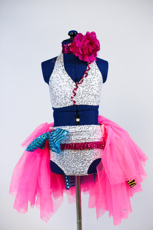 White/silver sequined bra & panty with turquoise sparkle bow accent on right hip. Knee length skirt with layers of pink,yellow & turquoise & fuschia hair piece. Front