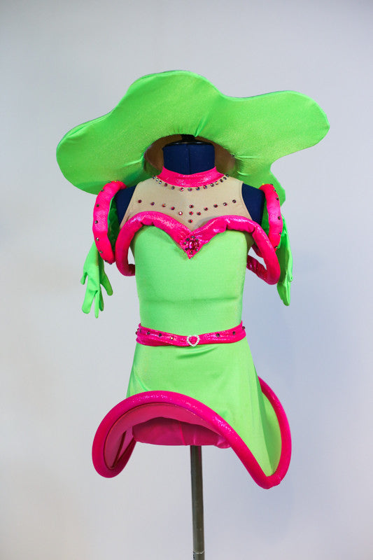 Neon green dress with attached shorts and mesh neckline Clear plastic tubing gives hooping effect. Matching gloves and a large hat in shape of a fried egg. Front