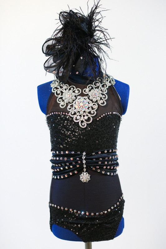 Black mesh bodysuit with crystals has waistband covered with 5 rows crystals and pendant. Entire chest is  large Swarovski necklace (gloves and hair piece).Zoomed