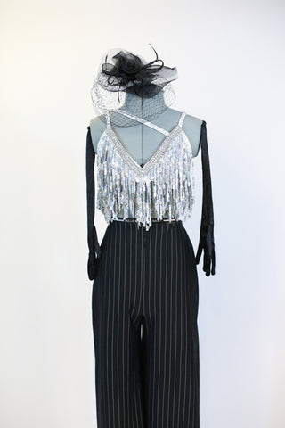 Black pin-stripe Zoot-Suit pant with a white/silver sequined &crystal bra that has fringe of dangling beads. Includes black headpiece and long gloves . Front