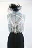 Black pin-stripe Zoot-Suit pant with a white/silver sequined &crystal bra that has fringe of dangling beads. Includes black headpiece and long gloves . Zoom front