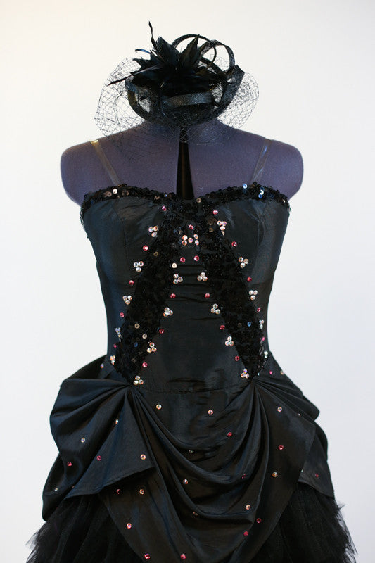 Black taffeta dress with black sequin detail has layers of tulle and crinoline, pink and AB Swarovski crystals, Comes with black head piece. Zoomed