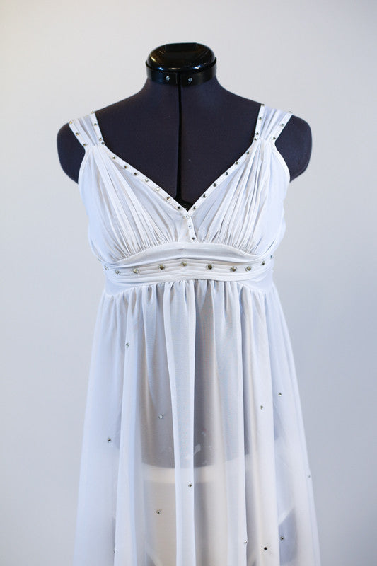 White chiffon dress with pleated bodice is speckled throughout with silver crystals. Comes with white panty (require sticky-cups). Comes with hair accessory. Zoom