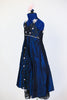 Long ballroom gown of navy iridescent taffeta, has halter-type neckline ,front brocade insert, crystal detail and pale pink appliqués. Has pink hair piece. Side