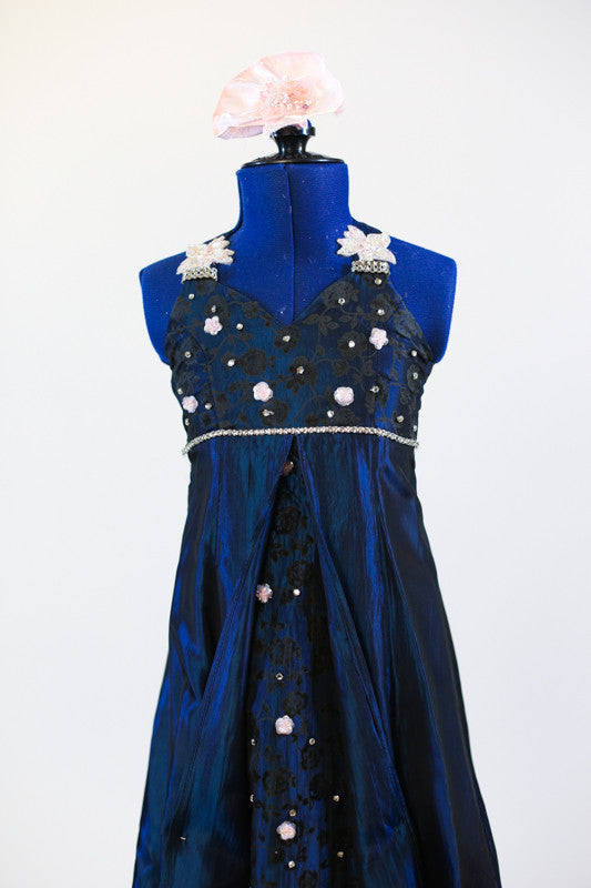 Long ballroom gown of navy iridescent taffeta, has halter-type neckline ,front brocade insert, crystal detail and pale pink appliqués. Has pink hair piece. Zoomed