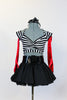 Striped, crop-top with neck-strap and short black, crinoline lined taffeta skirt, wide black patent leather belt, long red gloves and black bow headband. Front