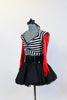 Striped, crop-top with neck-strap and short black, crinoline lined taffeta skirt, wide black patent leather belt, long red gloves and black bow headband. Side