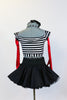 Striped, crop-top with neck-strap and short black, crinoline lined taffeta skirt, wide black patent leather belt, long red gloves and black bow headband. Back
