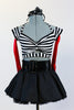 Striped, crop-top with neck-strap and short black, crinoline lined taffeta skirt, wide black patent leather belt, long red gloves and black bow headband. Zoomed