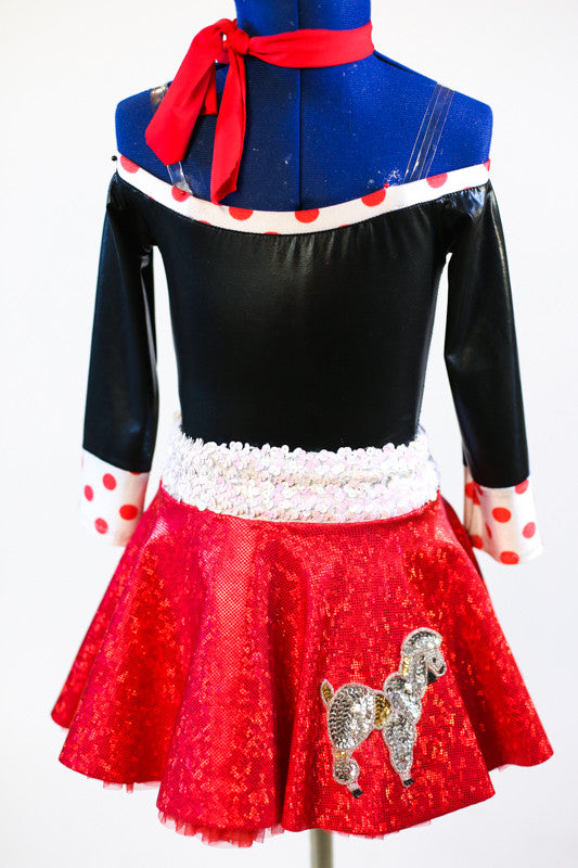 Black shiny off the shoulder body suit with white/red polk-a-dot trim/cuffs. Comes with a red, ruffled poodle skirt, white sparkle belt and red neck scarf. Zoomed