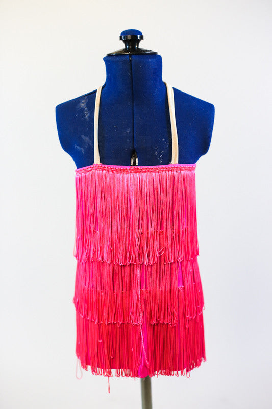 Hot pink 60's dress comprised entirely of layers of fringe. Has skin colour straps and comes with a hot pink bouffant style wig with bangs. Zoomed