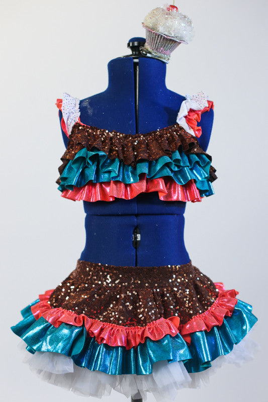 Turquoise-gold-coral sequined top has white ruffles & matching ruffled  sequined skirt with an attached panty. Has large cupcake hair piece with a cherry on top. Front zoom