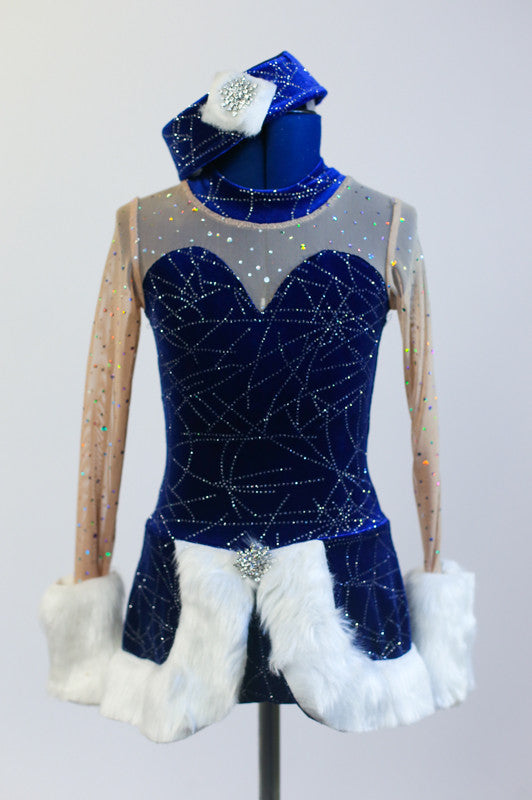 Royal blue, sequined velvet dress has sweetheart neckline with covered clear mesh. The skirt and wrists have a wide white fur trim & a matching velvet pill hat.Front zoomed