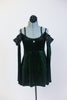 Green, sparkle velvet, off the shoulder, tunic dress has crystals, long sleeves & black chiffon draping at the shoulder. Comes with black floral hair accessory. Front