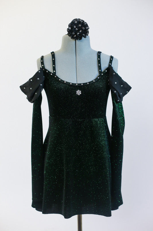 Green, sparkle velvet, off the shoulder, tunic dress has crystals, long sleeves & black chiffon draping at the shoulder. Comes with black floral hair accessory. Front zoomed