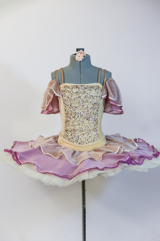 Professional ivory platter tutu, has rose/cream chiffon overlay and shoulder draping. Velvet bodice has gold sequined front. Comes with floral hair accessory. Front