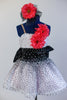 White base has crystal mesh overlay with a cascading spray of black velvet dots over white and  pink tulle. 2 coral daisies on bodice match the hair accessory. Front zoomed