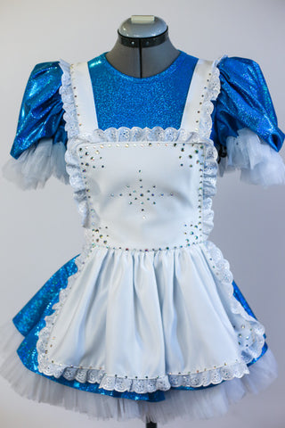 Blue sequined dress with pouffe sleeves, has an attached panty and layered petticoat skirt. Has an attached white pinafore apron and a black headband. Front zoom