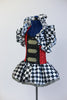 Black &White harlequin pattern dress has red/black sequined a bodice with crystal buckle accents and a large harlequin collar. With black top-hat 9 of hearts. Side