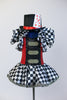 Black &White harlequin pattern dress has red/black sequined a bodice with crystal buckle accents and a large harlequin collar. With black top-hat 9 of hearts. Front with top-hat