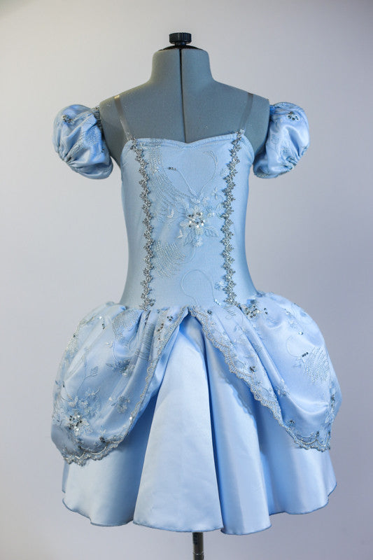 Ice blue Cinderella dress with detachable pouf sleeves & long white gloves. The dress has a beaded lace overlay and silver accents. Comes with matching headband Front zoom