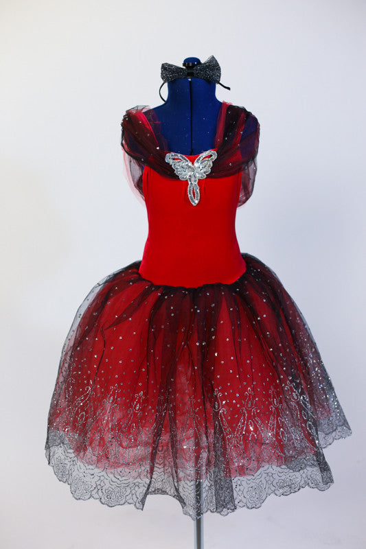 Red tutu dress has attached black/silver scalloped lace tutu skirt with red tulle beneath. Silver sequined applique and lace shawl collar adorn bodice. Front