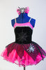 Black & pink leotard with spider-web, silver trim & spider applique. Comes with hot-pink  pull on skirt with black net  overlay & pink spider bow hair piece. Front zoomed