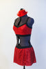 Red sequined bra top has black edging, criss-cross straps and a matching skirt with attacked black shorts. Comes with mini red jazz hat accessory. Side