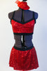 Red sequined bra top has black edging, criss-cross straps and a matching skirt with attacked black shorts. Comes with mini red jazz hat accessory. Front Zoom