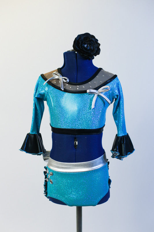 Turquoise half top has ¾ sleeves, mesh collar with crystals & silver bows. Bottom is panty/skirt with  black ruffles &  silver bow . Has matching head piece. Front