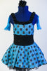 Blue glitter dress has black polk-a-dots & black gathered waistband. Dress has layered black petticoat skirt, blue gauntlets & black flower hair accessory. Front zoomed