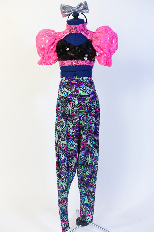 Black sequined half-top with neon pink high collar,pouff sleeves & open back with blackcorset ties. Comes with neon hip-hop harem pant & silver bow headband. Front