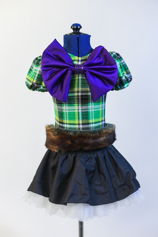 Green tartan print leotard with  large purple metallic bow comes with black taffeta skirt with layered white petticoat & a fur belt with white ribbon sash. Front