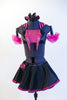 Black half-top has pink sequin insert, fringe & halter style striped collar. Has a black skirt, with pink petticoat & panty.Comes with  gauntlets & hair piece. Front
