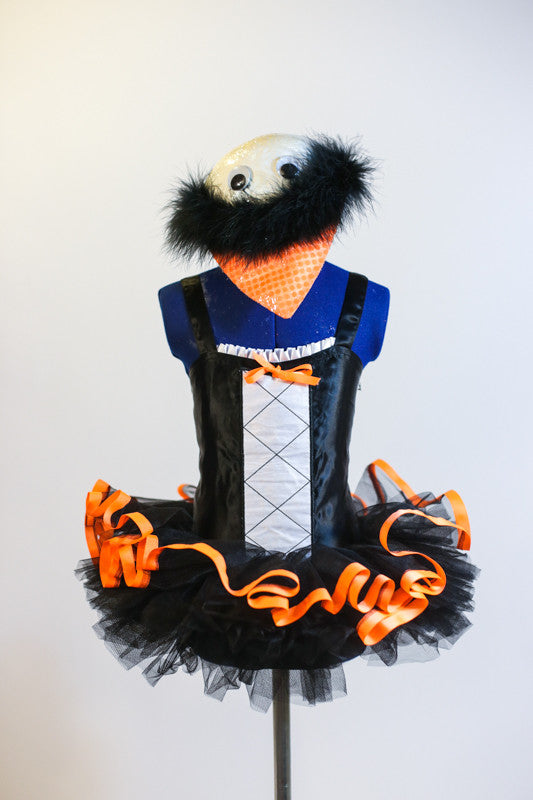 Black penguin leotard with white front & orange bow has pull-on black tutu with orange trim &white shiny hat with black marabou trim, beak & googly eyes. Front