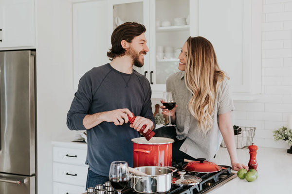 A couple prepares a healthy meal