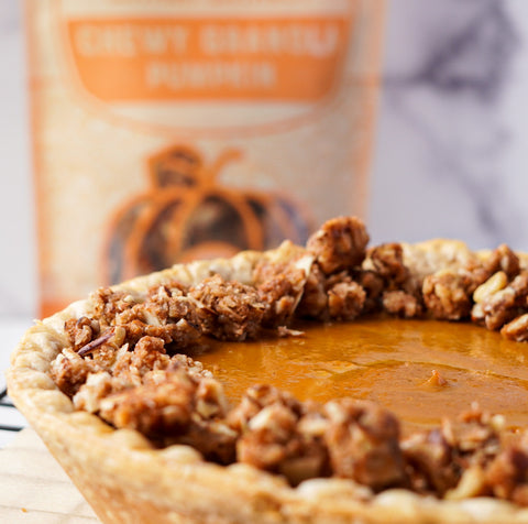 Close up of paleo pumpkin pie with bag of granola in background