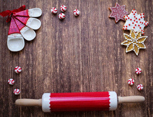 Holiday rolling pin with cookies and mints