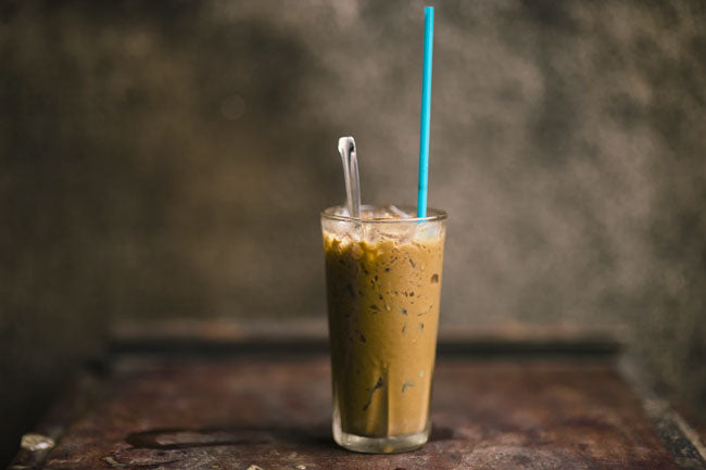 A glass of creamy iced coffee as an example of food gifts for Dad