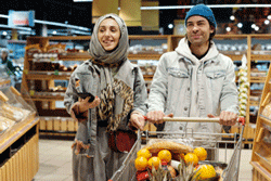 A Smiling Couple Shops at a Grocery Store