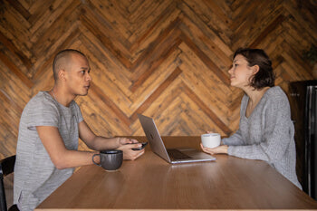 Two people with laptop at coffee shop